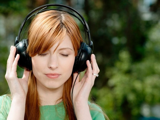 Girl wearing headphones. : Stock Photo