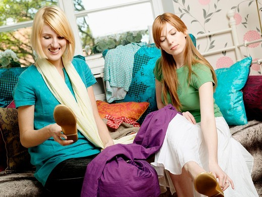 Two girl trying on a ballerina shoes. : Stock Photo