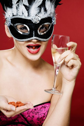 Young woman wearing a carnival mask. : Stock Photo