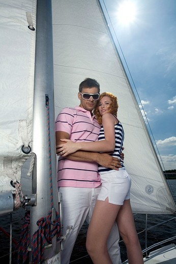 Stock Photo: 4123-28879 Couple resting on the sailing boat