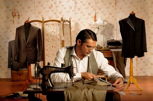 Stock Photo: 4123-29142 Tailor dressmaker at work.