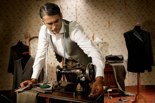 Stock Photo: 4123-29153 Tailor dressmaker at work.