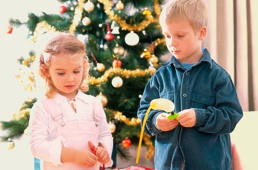 Children at the christmas tree : Stock Photo