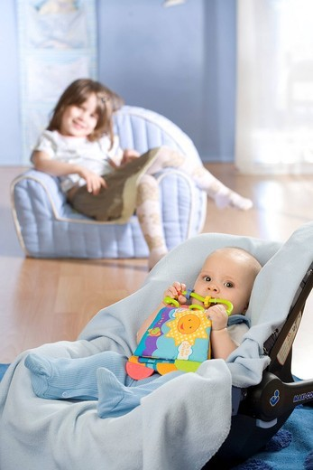 Girl with little brother. : Stock Photo