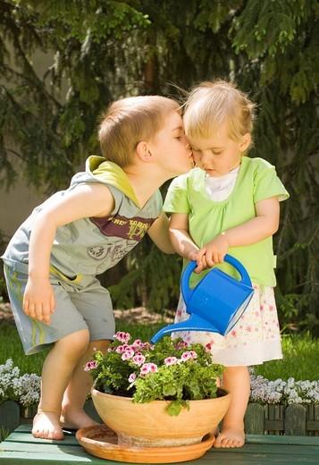 Children playing in the garden. : Stock Photo