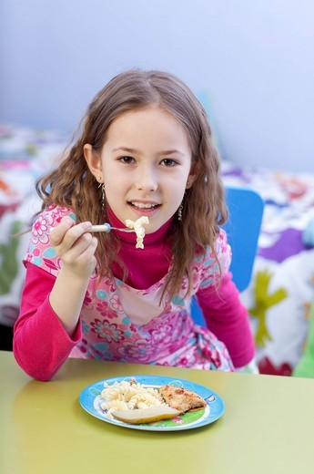 Girl eating a meal. : Stock Photo