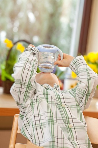 Little boy drinking from the bottle : Stock Photo