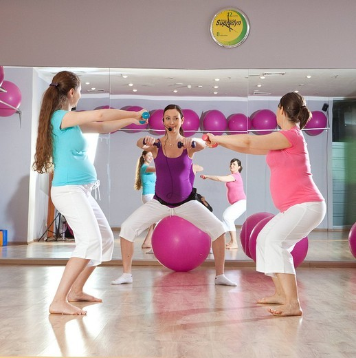 Stock Photo: 4123-31266 Pregnant women during exercising.