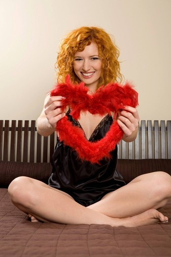 Young woman with heart shape Valentine´s day decoration. : Stock Photo