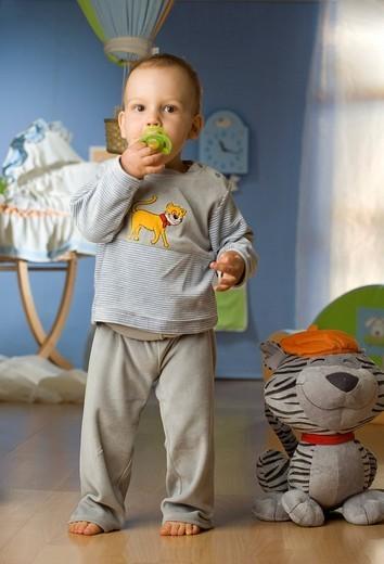 Boy wearing pyjama playing at home : Stock Photo