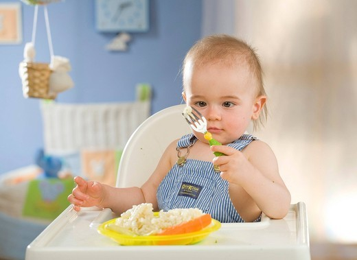 Stock Photo: 4123-32200 Baby having dinner.