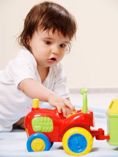 Child playing with toy : Stock Photo