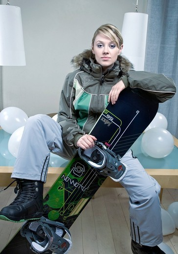 Stock Photo: 4123-32948 Young woman with snowboarding equipment.