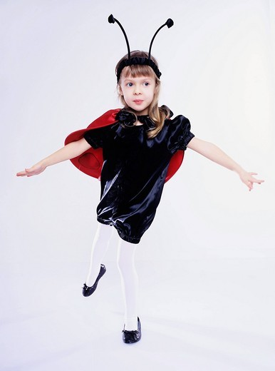 Girl wearing ladybird disguise : Stock Photo