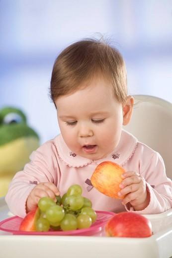 Stock Photo: 4123-33304 Baby having dinner.