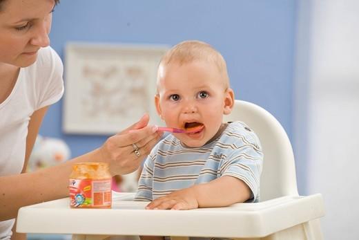 Baby having dinner. : Stock Photo