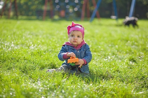 Little girl in the park. : Stock Photo