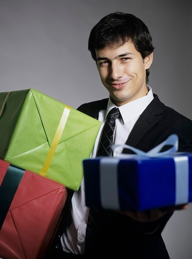 Man holding gifts : Stock Photo