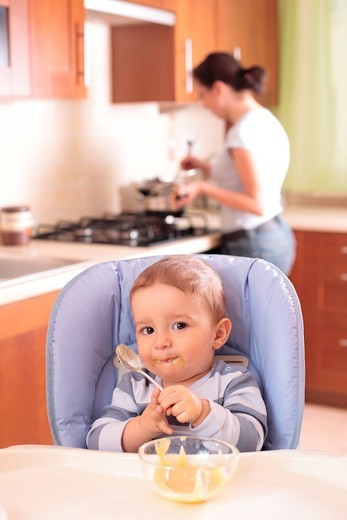 Baby boy eating vegetable pure : Stock Photo