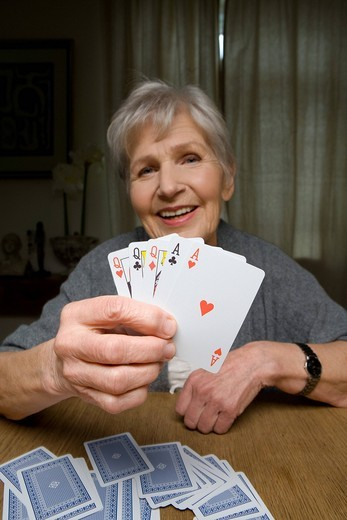 Stock Photo: 4123-36213 Old lady playing cards