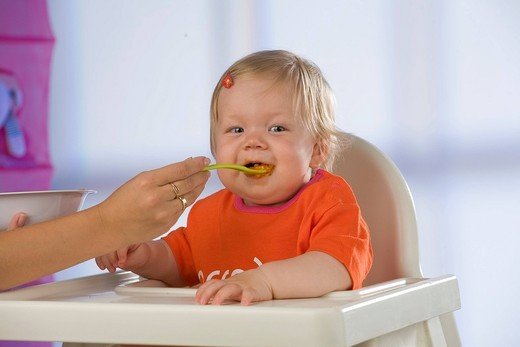 Stock Photo: 4123-36410 Baby having dinner.