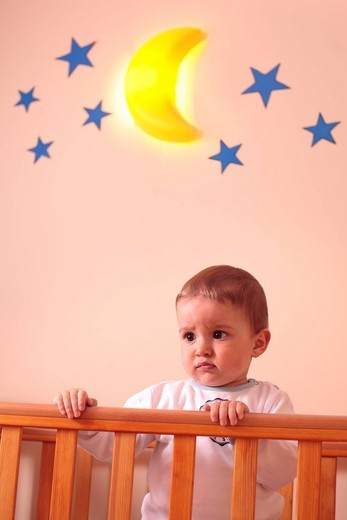 Baby boy in the cot : Stock Photo