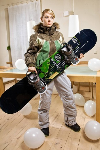Young woman with snowboarding equipment. : Stock Photo