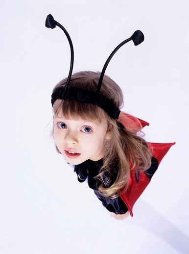 Girl wearing ladybird costume : Stock Photo
