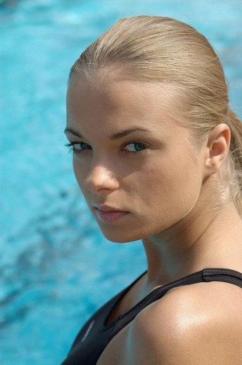 Stock Photo: 4123-3772 Woman at the swimming pool