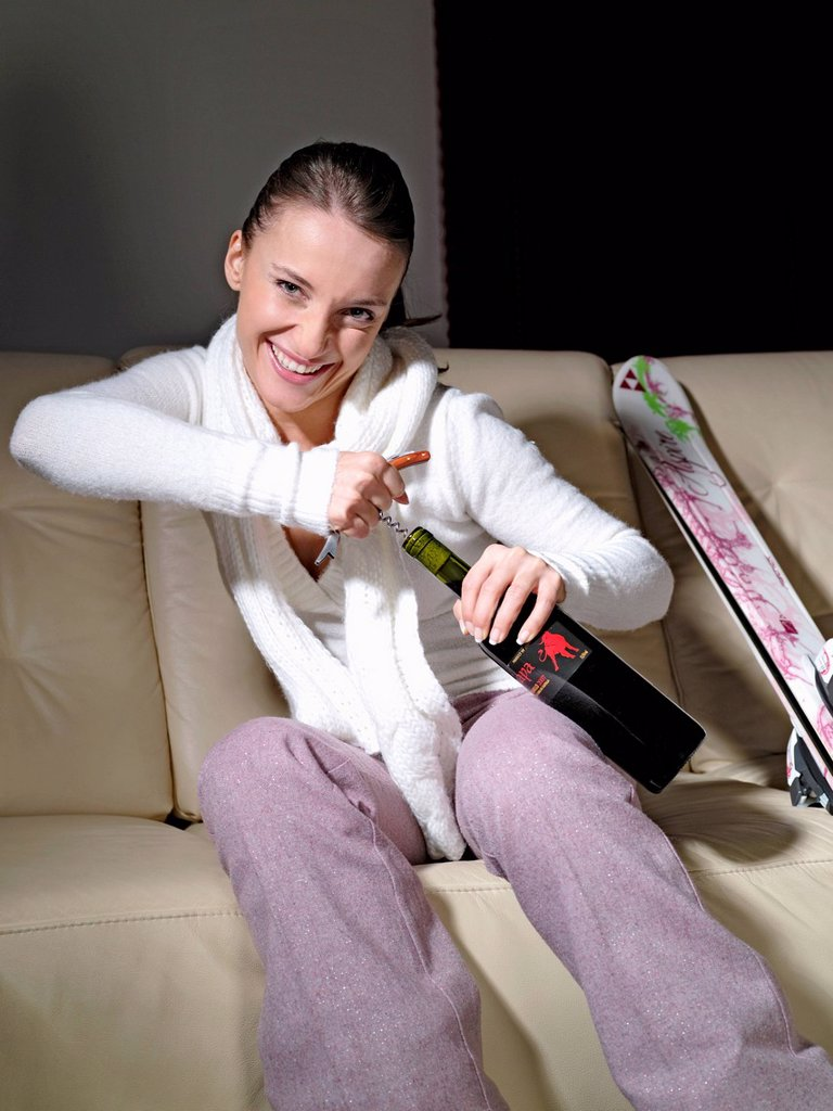 Woman drinking alcohol after skiing. : Stock Photo