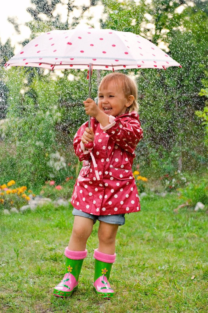Little girl with umbrella. : Stock Photo