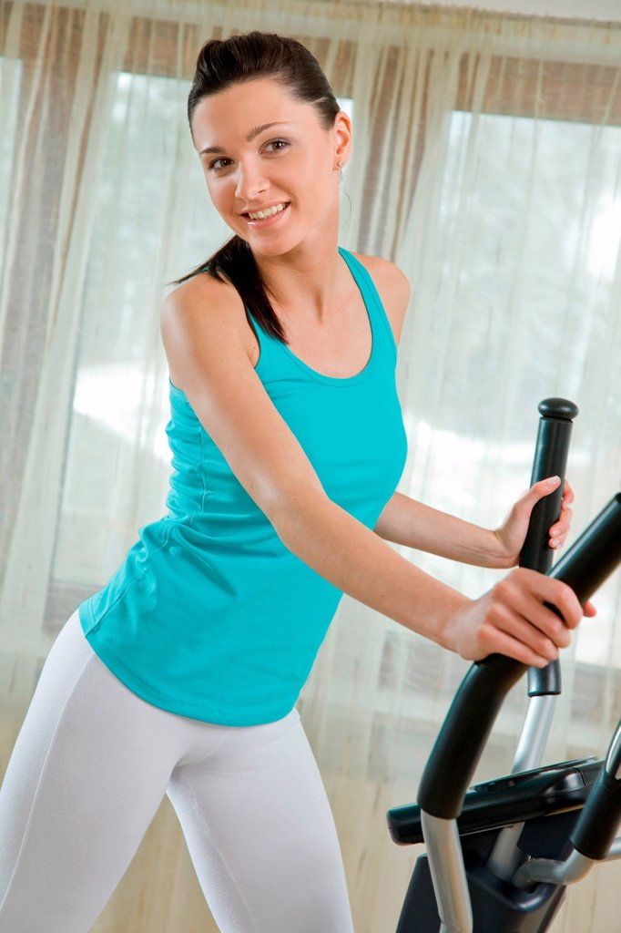 Woman doing exercises on stepper. : Stock Photo