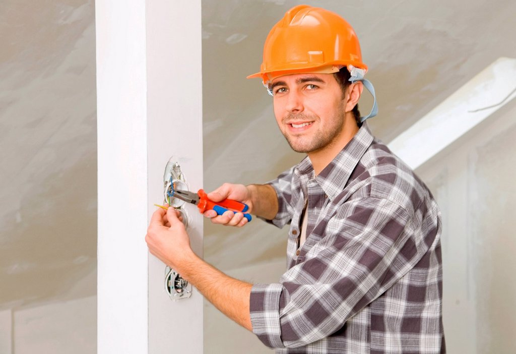 Stock Photo: 4123-38955 Young man using pliers.