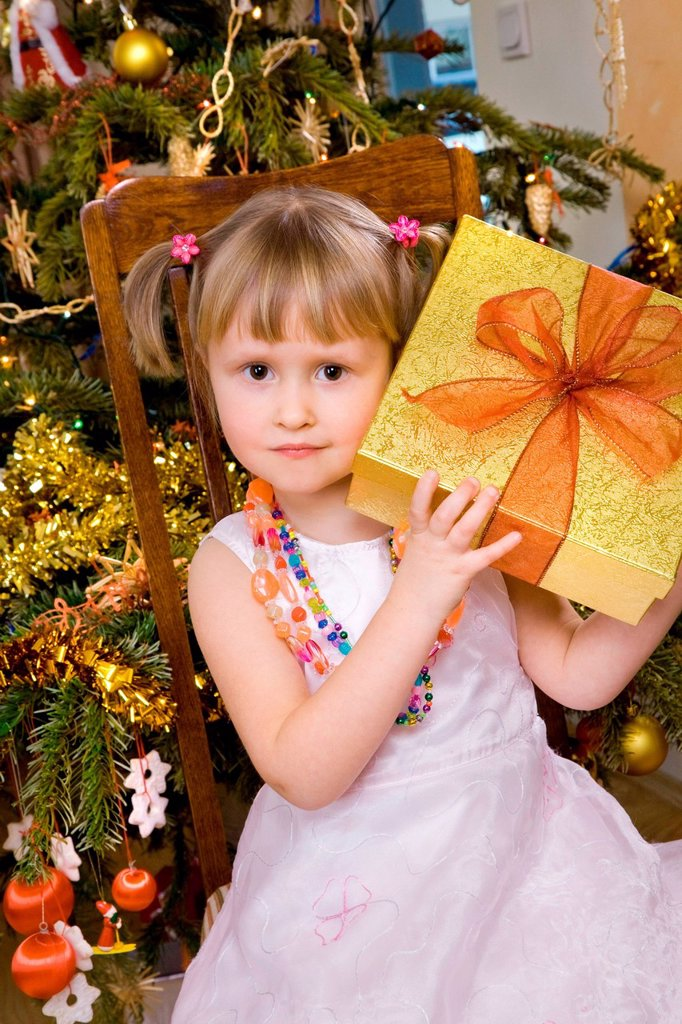 Girl with Christmas present. : Stock Photo