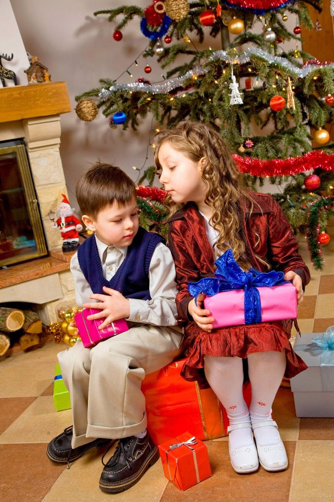 Stock Photo: 4123-40166 Children waiting for opening presents.