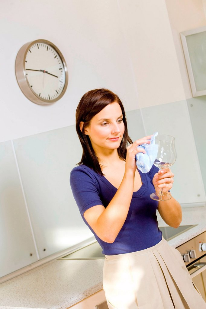 Stock Photo: 4123-41505 Woman cleaning glass.