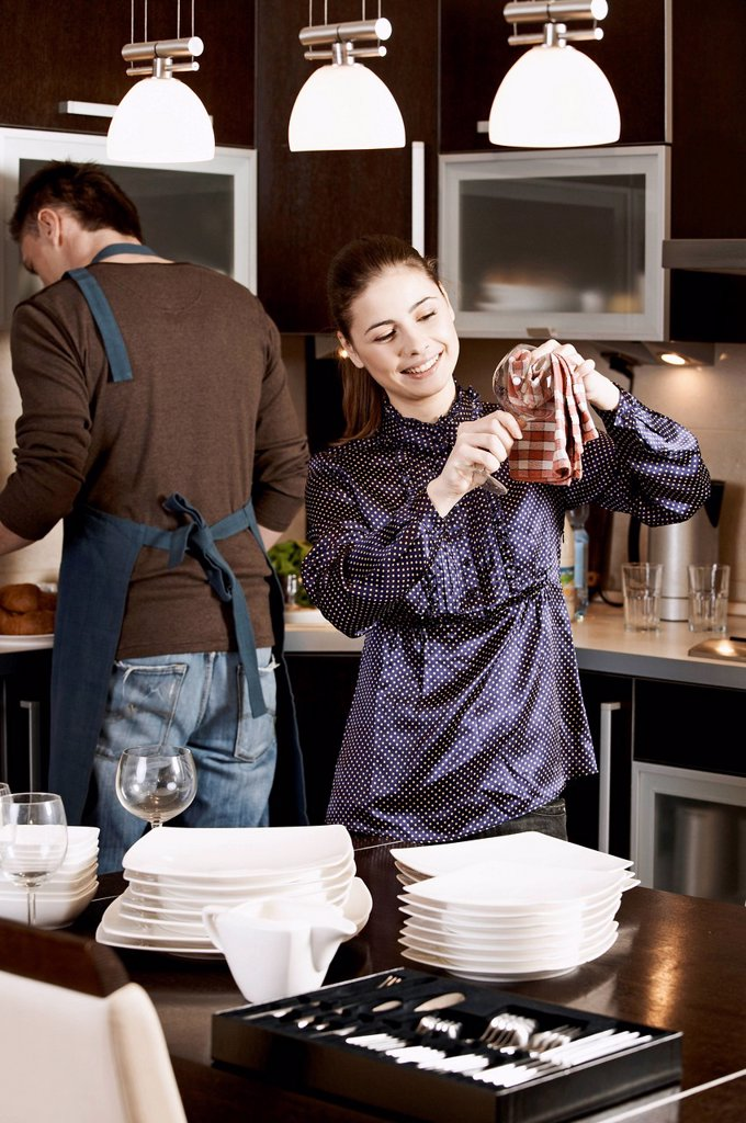 Stock Photo: 4123-41703 Woman wiping dishes in the kitchen