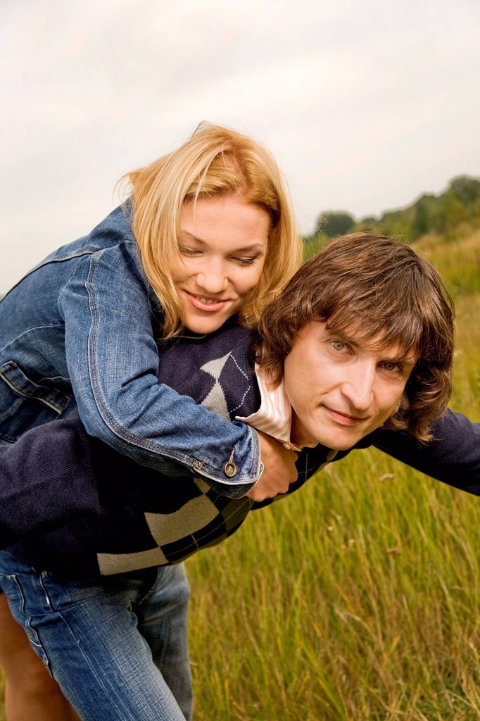 Stock Photo: 4123-42479 Couple spending free time on the meadow.
