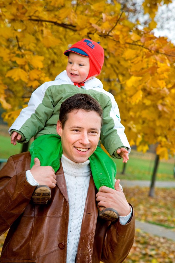 Stock Photo: 4123-42876 Man and his son spending time int the park.