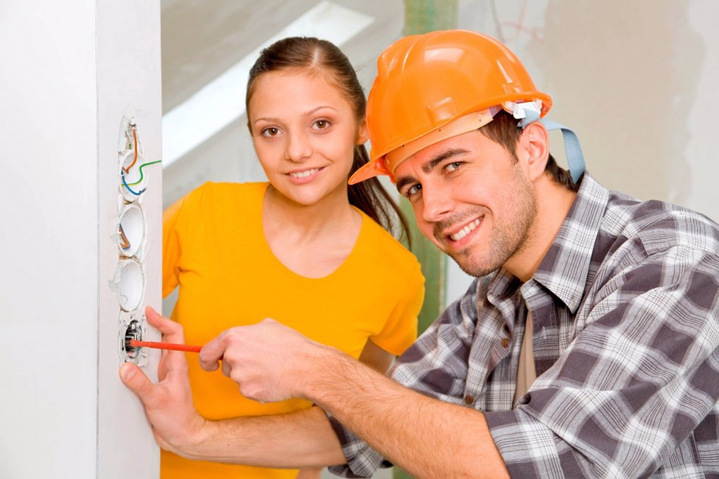 Young man using screwdriver. : Stock Photo
