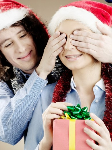 Portrait of a young man giving a present to a woman. : Stock Photo