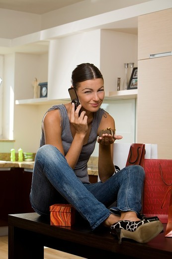 Stock Photo: 4123-4704 Woman talking on the phone