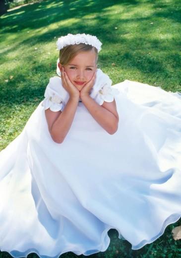 Girl wearing communion dress : Stock Photo