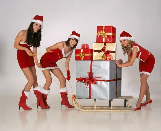 Stock Photo: 4123-5926 Three girls in christmas disguise
