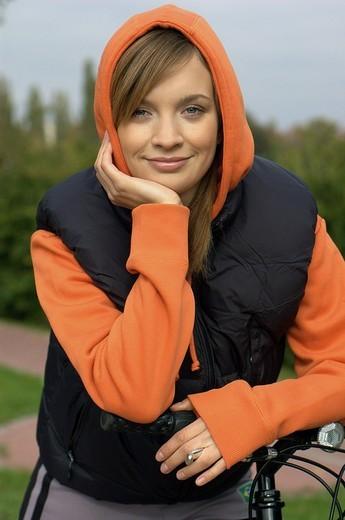Girl on the bike in park : Stock Photo