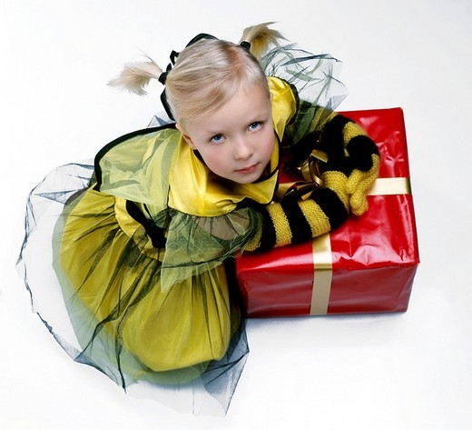 Little girl wearing bee disguise : Stock Photo