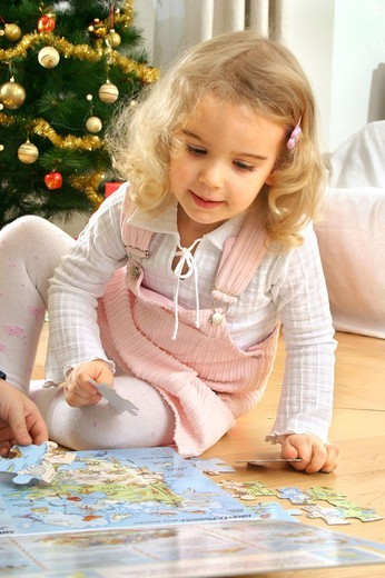 Girl with puzzle : Stock Photo