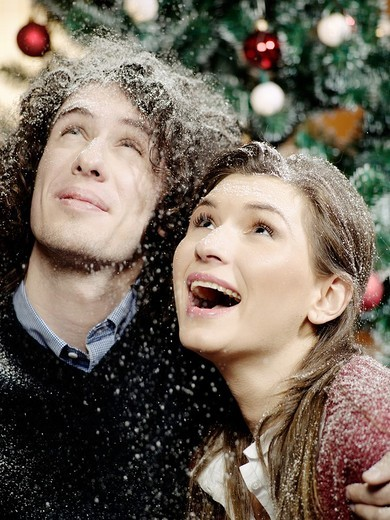 Portrait of a young couple during Christmas. : Stock Photo