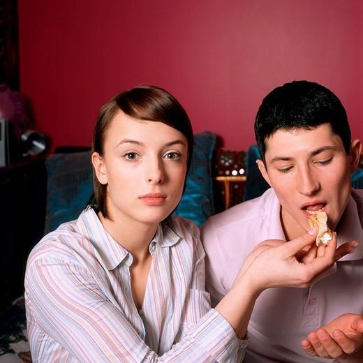 Woman feeding man : Stock Photo