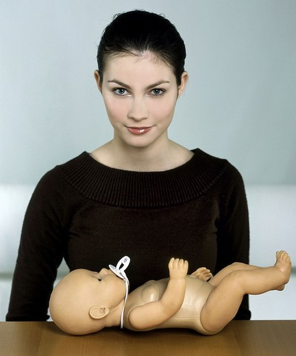 Stock Photo: 4123-9074 Woman with doll
